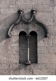 Artistic doulble lancet window medieval of the old basilica of Santa Maria in Randazzo