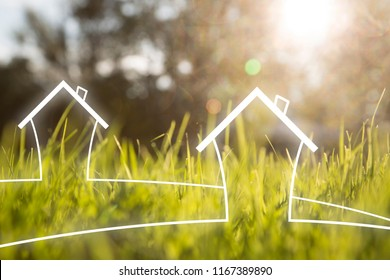 Artistic eco healthy living house symbols on sunny blurred meadow background.