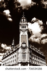 Artistic high-contrast sepia-toned monochrome image of the upper part of the Chamber of Commerce (Chambre de Commerce) in Lille, France