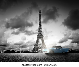 Artistic image of Effel Tower, Paris, France and retro car. Black and white, vintage.