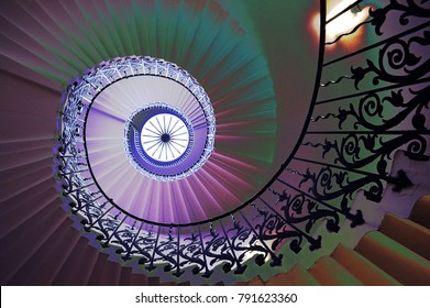 Artistic image of spiral staircase, the Tulip Stairs in Greenwich London, with psychedelic colours and photoshop effects