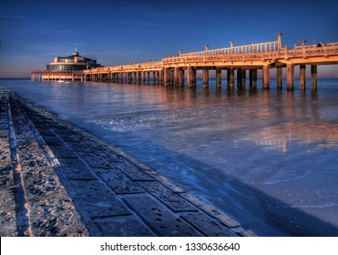 An artistic long exposure of the pier in Blankenberge by the North Sea, Belgium.