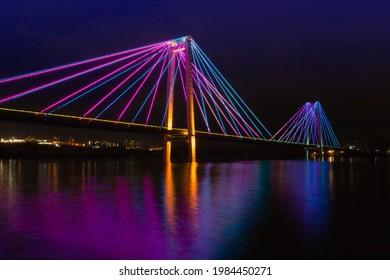 Artistic night view on colorful illuminated of suspension bridge in Krasnoyarsk, Russia