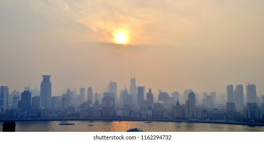Artistic Panoramic View (Aerial Shot) of Downtown Shanghai, with a Hazy Sun Slowly Setting Beyond - Shanghai, China