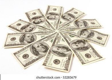 Artistic pattern made from dollar bills Snowflake or star Isolated on white background
