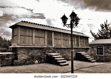 artistic photography in siena tones of old hórreo Galician of chestnut wood and marble from Moeche, Toelo, seen from the side, is very strict, as are these buildings in Galicia
