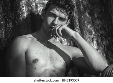 Artistic portrait of handsome sexy male model posing shirtless outdoors with beautiful eyes. Black and white.