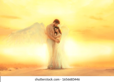 artistic processing. embrace hug heaven angels with white wings. Man kiss female head long hair. pressed strong male chest Model fantastic costume pastel colors. Backdrop bright sunny sunset desert