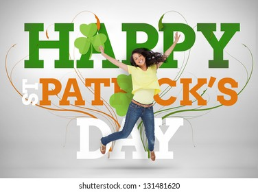 Artistic st patricks day message with jumping girl and shamrocks