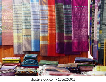artistic variety shade tone colors ornaments patterns of traditional cultural thai textiles with decorative ornaments crafts by local people hanging in a village of northern province of THAILAND