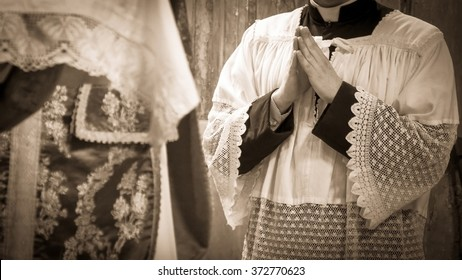 Artistic vintage sepia edit of an altar boy or a mass server in surplice during the traditional tridentine latin catholic mass