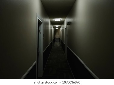 Artistic vision of a ghost of a woman standing in a hallway.