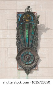 Artistic wall clock on the main square of Lecce, Italy