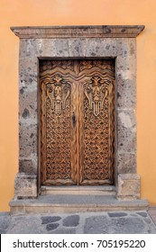 Artistically carved wooden door, Colonial style house in san Miguel de Allende Mexico