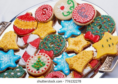 Artistically Decorated Cut Out Christmas Cookies On Silver Platter