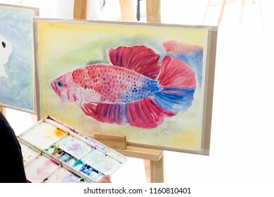The artistry is drawing beautiful fish.