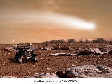 An artist's depiction of the close pass of comet C/2013 A1 over the Martian landscape.  It is scheduled to pass by Mars in October of 2014. Rover image courtesy of NASA.