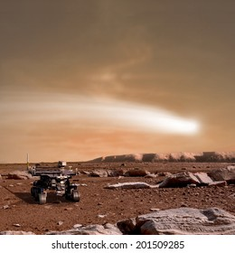 An artist's depiction of the close pass of comet C/2013 A1 over the Martian landscape. Also known as comet Siding Spring. It is scheduled for October of 2014. Rover image courtesy of NASA.