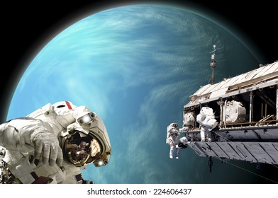 An artist's depiction of  a team of astronauts performing work on a space station while orbiting a large, alien planet. Some elements courtesy of NASA.
