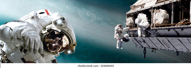 An artist's depiction of  a team of astronauts performing work on a space station while orbiting a large, alien planet. Elements of this image furnished by NASA.