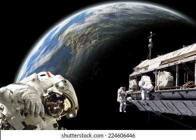 An artist's depiction of  a team of astronauts performing work on a space station while orbiting a large, Earth-like planet. Elements of this image furnished by NASA.