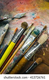 Artist's equipment: paintbrushes, palette knife and palette.