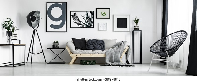 Artist's living room in minimal style with artworks