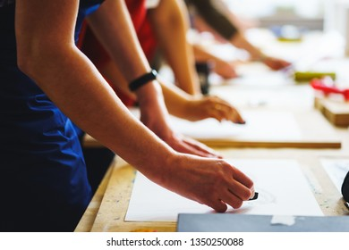 Artists make first strokes on blank canvas or sheet of paper while drawing with chalk charcoal pastel. Education art school. Several young artists start work his painting. Concept school of painting.