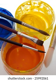 Artists paint pots and brushes on white