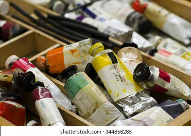 Artists paint tubes; used tubes of oil paints in work box; differential focus