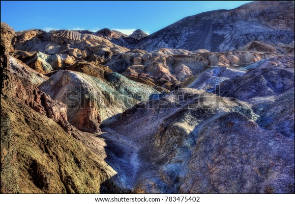 Artist's Palette is an area on the face of the Black Mountains noted for a variety of rock colors. These colors are caused by the oxidation of different metals.