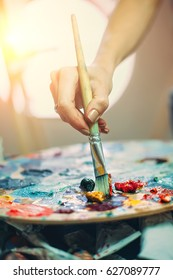 Artist's palette, close-up. Selective focus on the foreground. Background image.