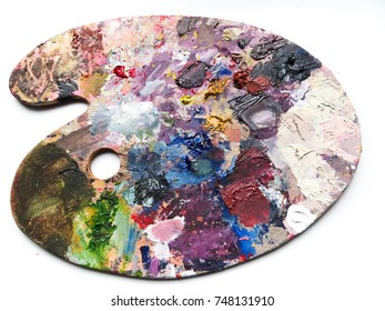 Artists palette with colors mix over white background. Modern background.