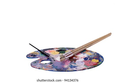 An artist's palette and paint brushes