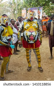 Artists play Pulikali (Tiger Dance) in the Vilangottu kavu Bhagavathi Temple Festival on March 10, 2019 in Karinganadu, Palakkad District, Kerala, India.