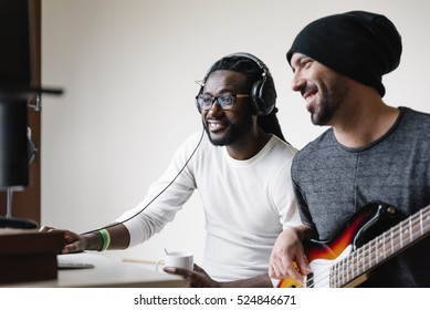 Artists producing music in their home sound studio.