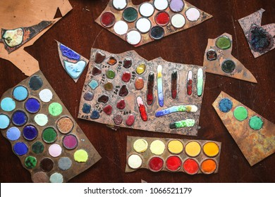 In the artist's studio samples of enamels on the table, a view from above. Concept creativity and design