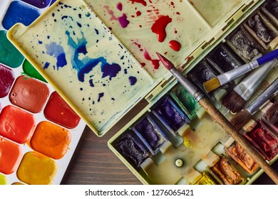artist's tools, professional watercolor paints in a box, brushes, watercolor palette