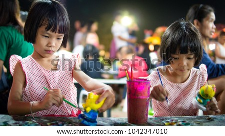 48e96b4223 Arts and crafts, Asian kids and cute girl child painting watercolor on doll  in market