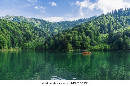 Artvin, Borcka/Turkey-06-05-2019: Unidentified people rowing in a boat in Savsat Karagol Nature Park in Blacksea region.