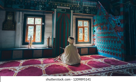 Artvin, Turkey - July 2018: Unidentified man praying in colorful decorated of the mosque in iremit maral village in Artvin, Turkey