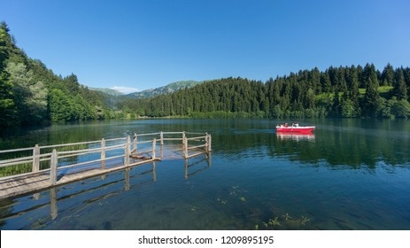 Artvin, Turkey - July 2018: Unidentified people rowing in a boat in Savsat Karagol Nature Park in Blacksea region, Artvin, Turkey