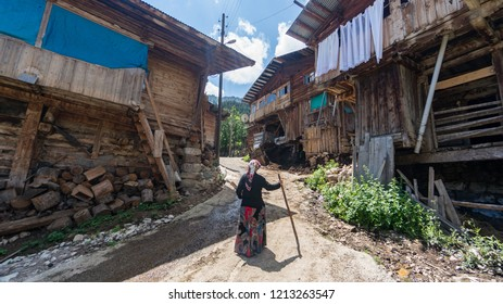 Artvin, Turkey - July 2018: Unidentified woman in local outfit walking in Maden Village , Savsat, Artvin, Turkey