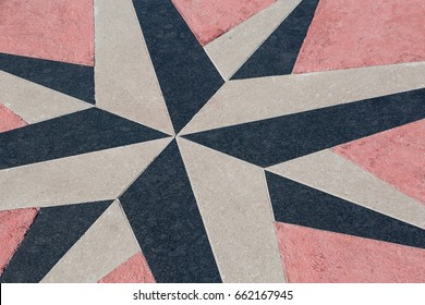 Artwork of a compass rose on a floor in Triest, Italy