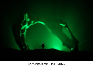 Artwork decoration with animal bone. Silhouette in an underground abandoned crypt. man standing in front of a cave entrance. Selective focus