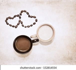 artwork  in grunge style,  two cups of coffee and heart symbols of coffee beans
