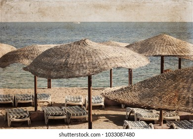 Artwork in vintage style; Sea landscape; beach umbrellas; Egypt; sharm el sheikh