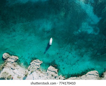 Aruba aerial above crystal clear water with boat