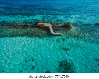 Aruba aerial above shack and crystal clear water