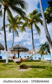 Aruba Caribbean Hammock on the beach with palm trees on the beach